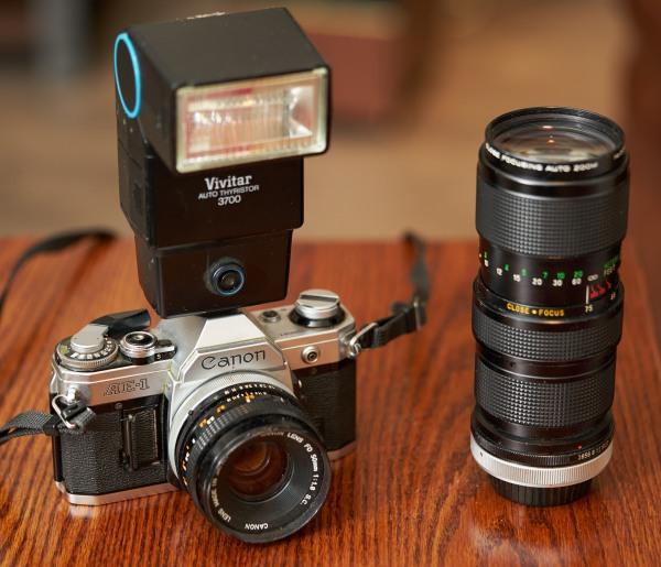Canon AE-1 with Vivitar flash and 70-210mm Vivitar Zoom lens.